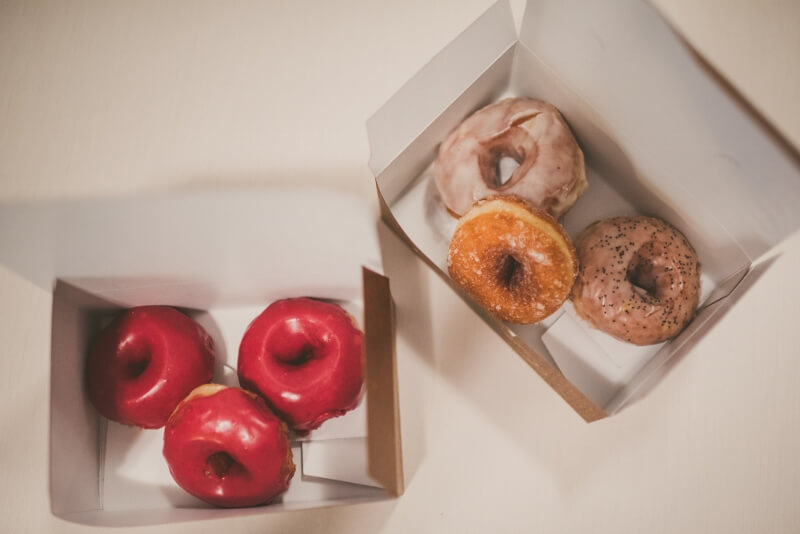 These to-go boxes filled with doughnuts are the perfect dessert and wedding favor all in one! At a Willowdale Estate wedding in Massachusetts - willowdaleestate.com